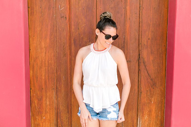 What I wore in Nicaragua: Chiffon high neck beaded top with distressed jean shorts! // www.thinkelysian.com
